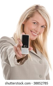 Portrait of young attractive blond businesswoman displaying mobile phone isolated on white background. Focus on phone