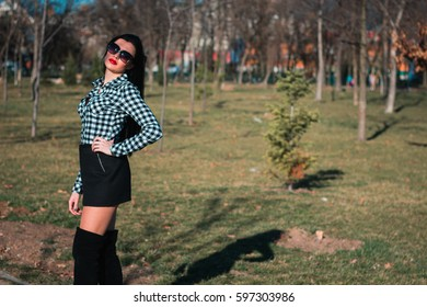 Portrait of a young and attractive brunettes girls in the park.