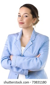Portrait of a young attractive business woman  standing with arms crossed
