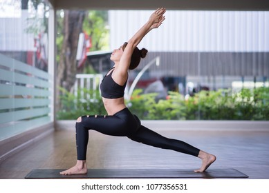 Portrait young attractive girl practicing yoga at gym. Fitness and exercise concept.