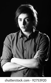 Portrait of young and attractive guy over black background
