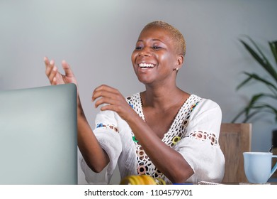portrait of young attractive and happy hipster afro American woman working on laptop computer smiling satisfied enjoying internet network in digital nomad work and lifestyle concept