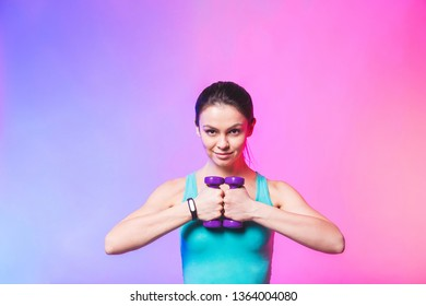 Portrait of young attractive happy woman in sport clothes with beautiful smile holding weight dumbbell doing fitness workout isolated on white background in healthy lifestyle concept