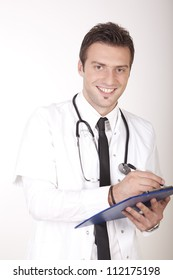 Portrait of a young attractive male doctor smiling.