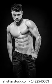 Portrait of Young attractive shirtless man showing his sculptural body. Black and white.