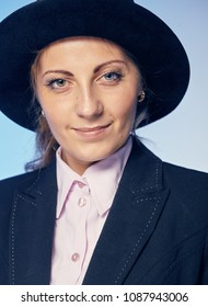 Portrait of a young attractive woman in a hat