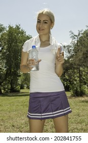 portrait of young attractive woman holding a bottle of water