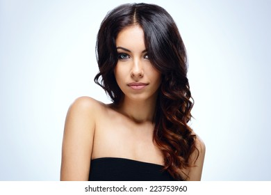Portrait of a young attractive woman over blue background