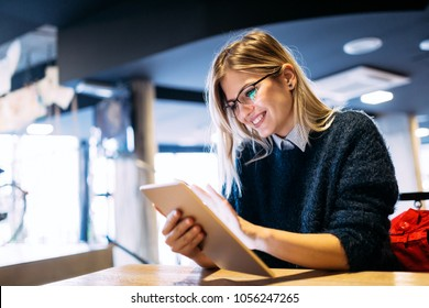 Portrait of young attractive woman using tablet