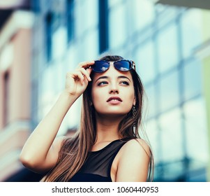 Portrait of young attractive woman wearing sunglasses. Summer beauty concept