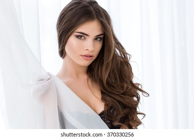 Portrait of a young attractve woman in black bra looking at camera