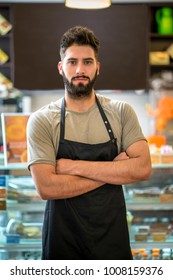 Portrait of a young barista man