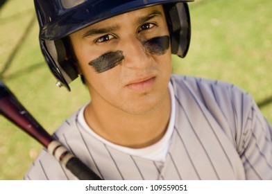 Portrait of a young baseball player holding bat
