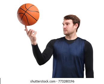 Portrait of a young basketball player in full growth, in blue uniform, with a ball on his finger, isolated on white background.