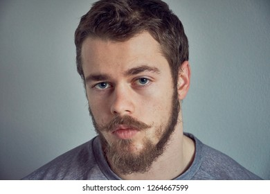 Portrait of young bearded caucasian man