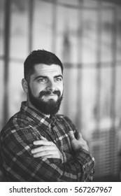 Portrait of a young bearded man, hipster posing