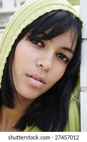 Portrait of young beautiful african american teen girl in green hood