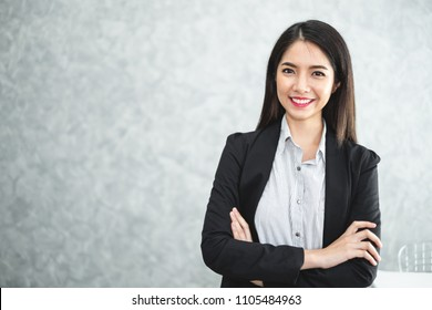 Portrait young beautiful asian business woman in formal suit in office