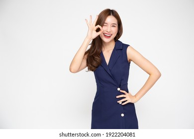 Portrait of Young beautiful Asian businesswoman smiling and showing ok sign on hand isolated on white background, Looking at camera
