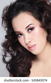 Portrait of young beautiful asian girl with curly hair