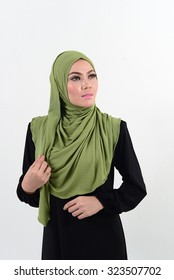 Portrait of young beautiful Asian muslim woman wearing hijab.