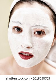 portrait of young and beautiful asian woman with facial mask
