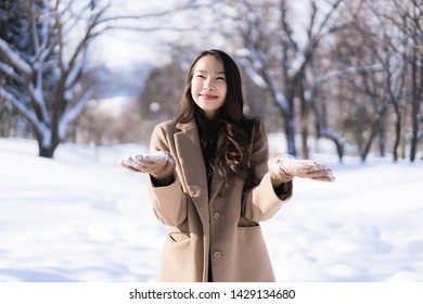 Portrait Young Beautiful asian woman smile happy travel and enjoy with snow winter season in Hokkaido Sapporo Japan