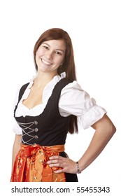 Portrait of young beautiful Bavarian woman in Oktoberfest Dirndl cloth. Isolated on white background.