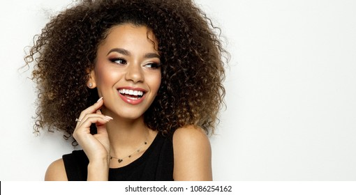 Portrait of young beautiful black woman smiling isolated on white