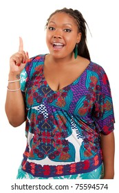 Portrait of a young beautiful black woman showing something, isolated on white background