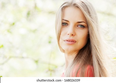 Portrait of young beautiful blond woman outdoors