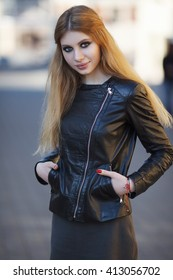 Portrait of young beautiful blond woman outdoors. Professional makeup. Smoky eyes. Beautiful natural hair. Slav. Street style.