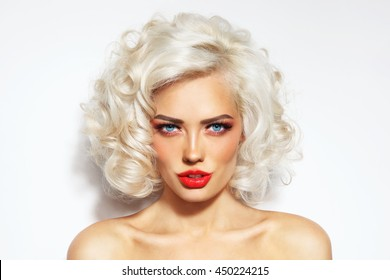 Portrait of young beautiful blonde sexy woman with stylish hairdo and red lips