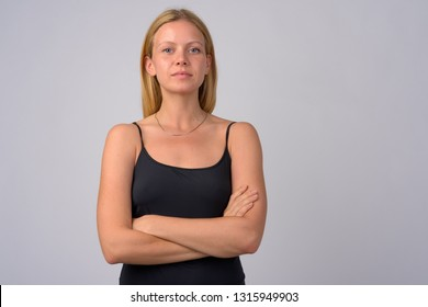 Portrait of young beautiful blonde woman with arms crossed