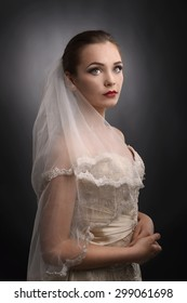 Portrait of a young beautiful bride isolated over gray background