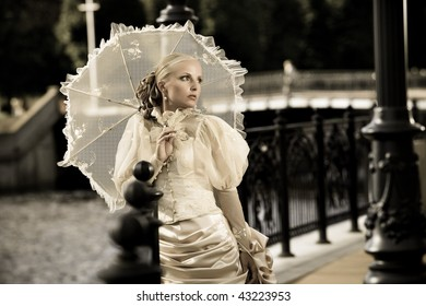 portrait of young beautiful bride with umbrella. retro style