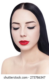 Portrait of young beautiful brunette with cat eyes eyeliner and red lipstick over white background