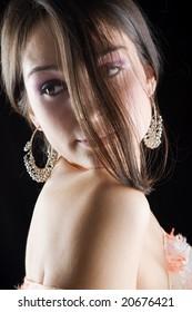 portrait of young beautiful brunette, dark background