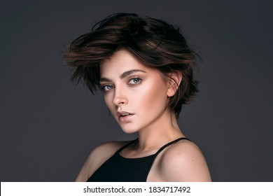 Portrait of a young beautiful brunette girl with short stylish hair