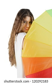 Portrait of Young, beautiful brunette looking side of a colorful umbrella