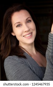 portrait of young beautiful brunette smiling woman