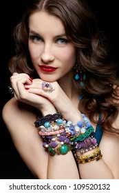 portrait of young beautiful brunette woman in jewellery
