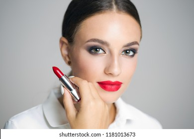 Portrait of a young beautiful brunette woman  in heavy makeup.