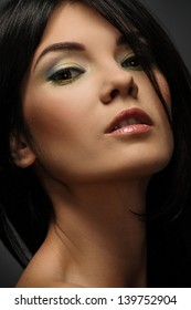 Portrait of a young beautiful brunette woman with make-up