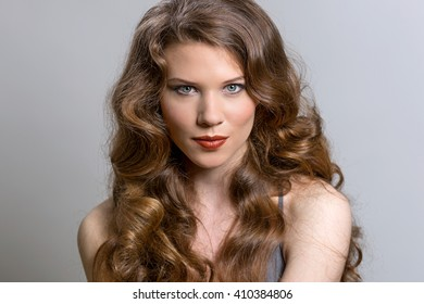 Portrait of a young beautiful brunette woman with long hair