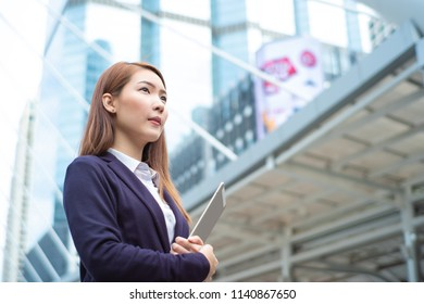 Portrait of young beautiful business woman in city