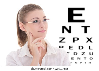 portrait of young beautiful business woman in glasses and eye test chart isolated on white background