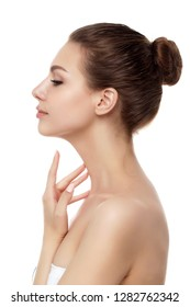 Portrait of young beautiful caucasian woman touching her neck isolated over white background. Cleaning skin, SPA therapy, skincare, cosmetology and plastic surgery concept