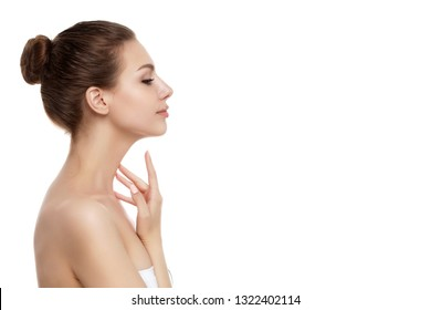 Portrait of young beautiful caucasian woman touching her neck isolated over white background. Cleaning skin, SPA therapy, skincare, cosmetology and plastic surgery concept. Copy space