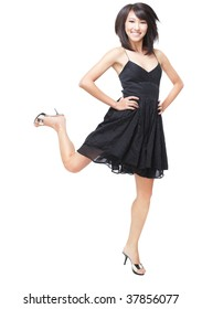 Portrait of a young, beautiful Chinese girl in black dress jumping with joy and excitement.  Focus on her eyes and face, motion blur with her feet to give a sense of movement